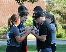 Teens participating in a team building exercise